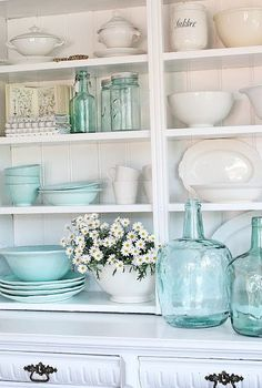 Beautiful tiffany blue kitchen decor idea:  bring a splash of tiffany blue into your kitchen by placing random tiffany blue bowls and glassware on your shelves. http://amzn.to/2jlTh5k