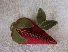 EMBROIDERED STRAWBERRY PINCUSHION << #sewing #pincushion #strawberry Note embroidered seam and leaf vein details.