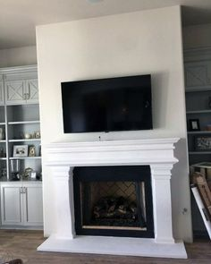Discover a frame to the masterpiece with the top 60 best fireplace mantel designs. Explore luxury interior surround ideas and architecture inspiration. Painted Fireplace Mantels, Inset Fireplace, Tv Above Fireplace, Wooden Mantel, Paint Fireplace, Home Fireplace, Fireplace Remodel, Living Room With Fireplace, Fireplace Surrounds