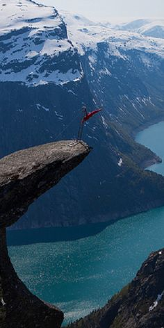 Balancing artist Eskil Rønningsbakken on Trolltunga in Hardangerfjord, Norway - late May 2012.