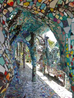 This outrageously colorful space is the home of two artists, Cheri and Gonzalo, who besides creating paintings have made it their life's work to cover their entire house, inside and out, with mosaic tiles.
