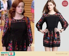 Tessa's black long sleeved floral dress and tan backpack on Suburgatory.  Outfit Details: http://wornontv.net/14672/ #Suburgatory