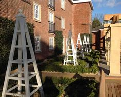 8 foot tall wooden garden obelisks set within gardens at The Belfry Hotel