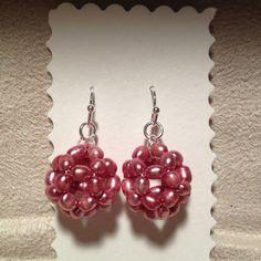 Pink pearl stringed bead ball earrings.