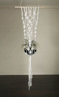 Small macrame pot hanging white.