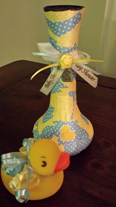 Purchased plain dollar store vases  Decorated with craft paper charm sticker and ribbon- Perfect match theme