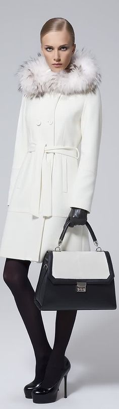 white coat with fur collar worn with black tights and heels