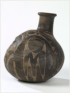 """Hodges engraved, head pot Year: 1600-1700 loan from the Proctor Collection of Henderson State University L2002.114  Only engraved example known. They may be representations of the head of a warrior""""s victim in warfare, and thus may be a ceramic representation of a real war trophy. They may conversely be a representation of an honored ancestor. The Caddo style of human representation shown here uses stylized renderings if eyes mouth, and other facial features."""