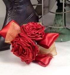 Persimmon satin rose wrist corsage from To Hold & To Have www.holdandhave.com