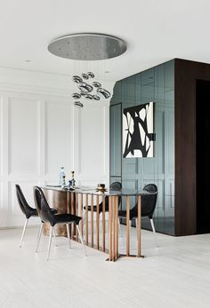 Slimline dining table gives an interesting dynamic to this space.