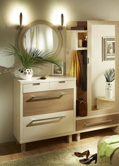 shoe storage cabinet and round mirror for entryway design