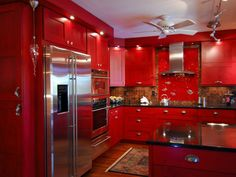 Not for the faint of heart, this red kitchen by John Ryba is saturated in a rich, lacquer red.  The white ceiling and stainless-steel appliances help reflect light, an important consideration when you are working with a darker color.