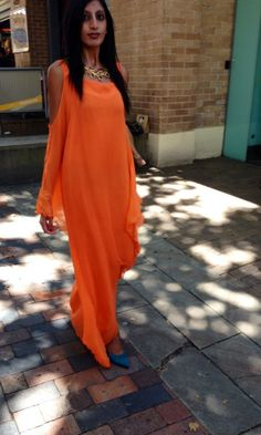 This stunning Tangarine, silk Georgette is a must have this summer.
