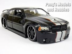 This model of the 2006 Dodge Charger is about 8 inches long, inches wide and inches high. It is highly detailed, with beautiful body paint and accurate markings. The headlights look quite rea Volkswagen Phaeton, Volkswagen Golf Mk1, Pontiac Gto, Chevrolet Camaro, Vw Gol, Bmw Classic Cars, Jaguar Xk, Audi A8, Car Brands