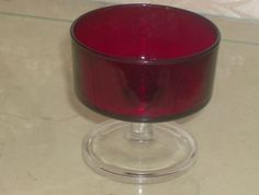 Vintage ruby Red glass cup with clear glass stem via Etsy