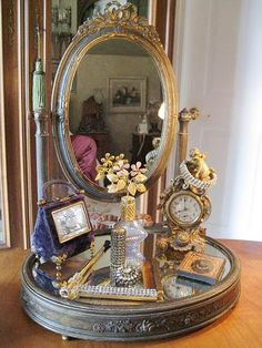 Pretty French dressing table mirror, cherub clock, perfume bottles