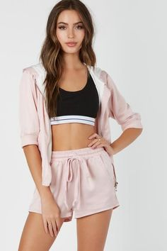 e32f969a19 Trendy silky bomber with cropped sleeves and hem. Front zip closure with  attached hood and