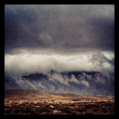Storm coming in over sandia mountains