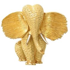 Henry Dunay Gold Platinum Elephant Brooch | From a unique collection of vintage brooches at https://www.1stdibs.com/jewelry/brooches/brooches/