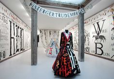 i like the way the dresses have been exhibited, also by using text around the room which really links in with the main pieces and feels like it creates a story,