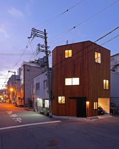 shaped by its small and narrow corner plot, this residence in osaka maximizes the area available through height, while interiors are distributed throughout a modest footprint over two main levels.
