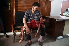 August 24, 2015 A man looks at the body of his daughter, who was killed following air raids by Syrian government forces. Child victims of air raids by Syrian government forces in the rebel-held city of Douma, Syria. Abd Doumany - 2016 Photo Contest | World Press Photo