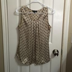 Sleeveless blouse 100% polyester. Tan and black polka dotted blouse. Tops Blouses