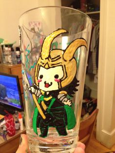 """I made this as a belated Christmas present for one of my friends. She loves Loki, so I found the cutest picture I could and puffy painted this glass for her. The back says """"Keep Calm and Join Loki's Army."""""""