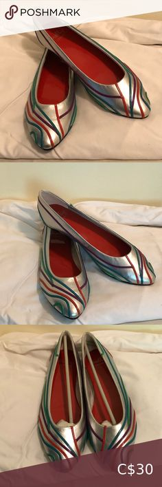 Silver Flats by Shelly London - Silver SZ 39 Silver Flats by Shelly London Silver with Multi Colored lines. These shoes will go with SO much! Brand New (no original box) SZ 39- Which I believe is a nine US/Canada but measuring the soul from toe to heal it's 10.5 inches Shellys London Shoes Flats & Loafers Black And White Flats, Metallic Loafers, Green Flats, London Shoes, Studded Flats, Silver Flats, Naturalizer Shoes, Green Suede, Loafer Flats