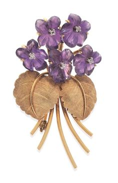 AN AMETHYST AND DIAMOND BOUQUET BROOCH  Comprising carved amethyst flowers, centred with a round brilliant cut diamond and textured leaves in 14ct gold.   Estimate $ 400-600  Sold for $ 550