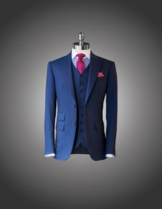 Suit Navy Pinstripe Suit 2 Button Jacket with Peak Lapels Straight Pockets with Ticket Pocket 9-Button Vest Shirt Spread Collar Tie Fuchsia Polka Dot MAB Tie