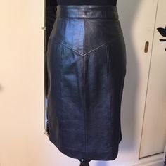"""Della Roufogali Vintage black leather skirt. Lamb skin leather. Flattering cut and details. High quality.  21"""" length.  Not stretched. Double snap, back zip closure. Waist measures 26"""". Della Roufogali Skirts"""