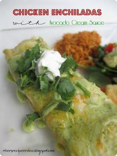 Chicken Enchiladas with Avocado Cream Sauce.  I can't even describe how amazing this cream sauce is!!  A great change to your normal enchilada!  YUMMY!