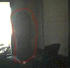 """They write, """"One day my brother and his friends went to this haunted, deserted house that's over 180 years old.  It's in Antioch, TN.  They brought their camera and took pics, and things showed up in the pics that weren't there.  I circled them in red.""""  Find out information on paranormal locations at http://www.panicd.com"""