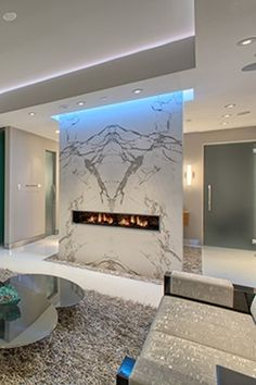 Dimplex Opti-V Duet electric fireplace set into book-matched marble at Mandarin Las Vegas.