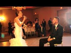 :-) I love this! I love the groom's face! Bride sings Etta James - At Last - to surprised groom - Amazing!