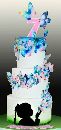 Girl Blowing Butterflies Cake Art
