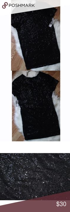 Victoria Secret Supermodel Essential Sequin dress Victoria Secret- Supermodel Essentials Black sequin dress. Dress does have a black underlining as well. Never Worn New with tags still attached. Size XS. Victoria's Secret Dresses Mini