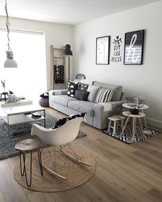 Love this funky mosh-mash of rugs and tables for the family room