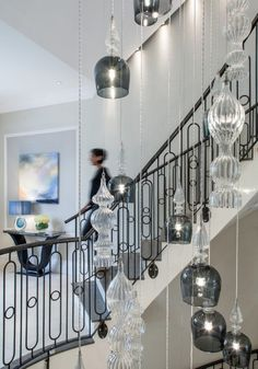 side view of chandelier in centre of curved staircase