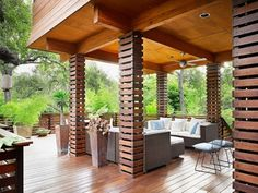 Cool columns....leave off a couple of planks in random locations, put in a solid bottom to hold plants?