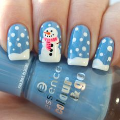Snowy the Snowman. Essence no. 125 Absolutely Blue base. OPI Alpine Snow for the snow slopes and little snowflakes. China Glaze Neon & On & On and OPI Strawberry Margarita for scarf. Rest of the details made with acrylic paints.