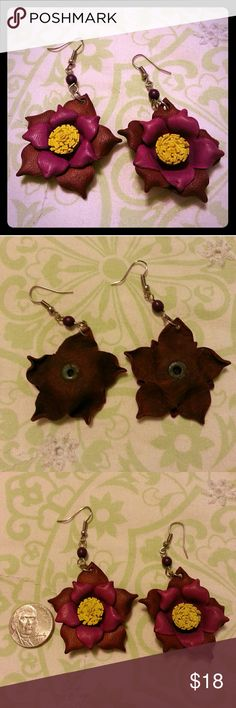Leather Flower Earrings Handcrafted leather flower earrings. Silver hooks accented by purple beads. Brown leather outer petals, fuschia leather inner petals. Yellow leather middle. Gorgeous.  Boho. I never wore these. Time to pass along. 1.5 inches  by 1.5 inches. Vintage Jewelry Earrings