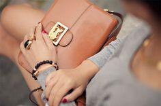 Big ring & brown leather bag