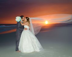 Such a sweet portrait with an amazing sunset! #DestinBeachPhotography #BeachPortraits #WeddingPortraits