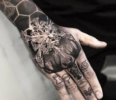 Snowflake with Deer tattoo by Niki Norberg