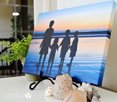 DIY Canvas Prints | How Does She... -- a different method of diy canvases, using a photo print wrapped around a canvas and textured with cream