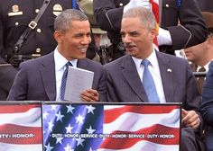 President Barack Obama (L) talks to Attorney General Eric Holder during the National Peace Officers' Memorial Service on the West Front of the Capitol Building on May 15, 2013 in Washington, D.C. UPI/Kevin Dietsch
