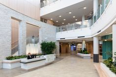 Outpatient medical services are a growing demand in the healthcare industry, so we collaborated with WellStar to redefine and evolve the outpatient building model. Holistic Wellness, Health And Wellness, Health Care, Healthcare Architecture, Architecture Design, Atrium, Open Concept, Natural Stones, Marble