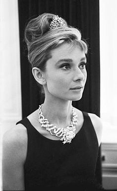 """soaudreyhepburn: """" Audrey Hepburn with Henry Platt, the V.I.P. and great grandson of Tiffany and Co wearing the Jean Schlumberger creation of the Tiffany yellow diamond while between filming Breakfast..."""